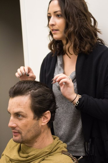 Working on hair styling on actor Alex Terzieff